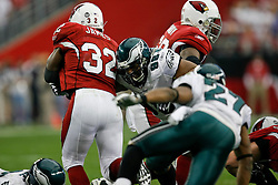 18 Jan 2009: Philadelphia Eagles defensive tackle Mike Patterson #98 gets his arms around Arizona Cardinals running back Edgerrin James #32 during the NFC Championship game against the Arizona Cardinals on January 18th, 2009. The Cardinals won 32-25 at University of Phoenix Stadium in Glendale, Arizona. (Photo by Brian Garfinkel)