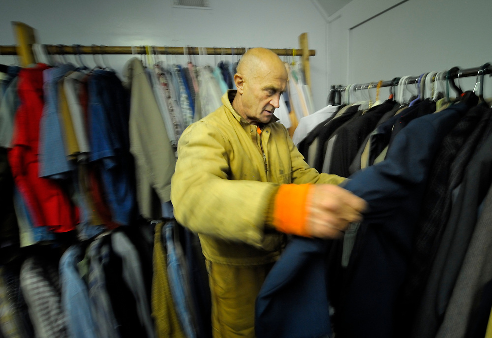Igor Sudarkin tries on clothes at the Thrift Shop, a project of United Methodist Women in Nome, Alaska. Sudarkin, a miner originally from Russia, is one of hundreds of new arrivals who've been lured to Nome by higher gold prices and a television reality show about mining in the Bering Sea community. The Thrift Shop is also supported by the Nome Community Center, a United Methodist Women-supported mission institution.