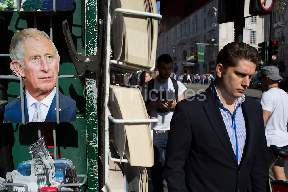 Tourist postcards of Prince Charles for sale near Piccadilly Circus, London, UK.