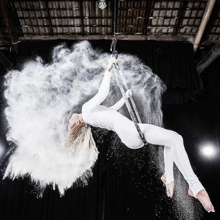Aerial dancer performance with flour