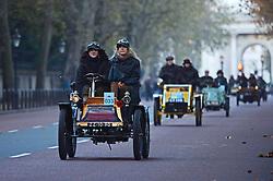 Participants in the Bonhams London to Brighton Veteran Car Run pass Wellington Arch in central London.