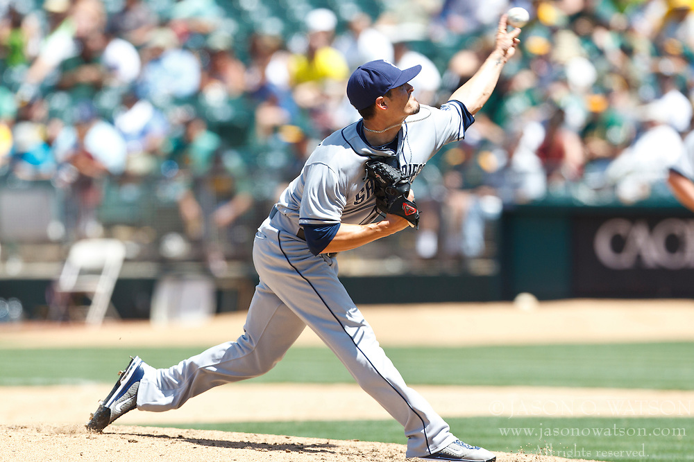 OAKLAND, CA - JUNE 16: Alex Hinshaw #41 of the San Diego Padres pitches against the Oakland Athletics during the fifth inning of an interleague game at O.co Coliseum on June 16, 2012 in Oakland, California. The Oakland Athletics defeated the San Diego Padres 6-4. (Photo by Jason O. Watson/Getty Images) *** Local Caption *** Alex Hinshaw
