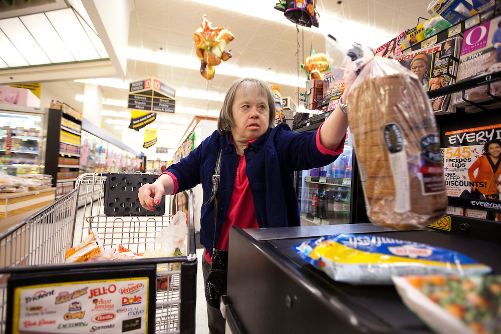 Mary Beth Solinski, a 59 year old, with Down Syndrome loads her grocerys onto a conveyor belt while grocery shopping at Dominick's grocery store...Aging adults with Down Syndrome. In 1983, people with Down syndrome could expect to live to age 25. Today, their life expectancy is 60 years. We interview a 59-year-old patient who has outlived her parents and is now in AARP. She has trouble walking, but has lots of interests, such as cooking, arts and crafts and reading.