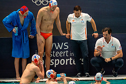 Coach Harry van der Meer, Jesse Nispeling of the Netherlands in action against Romania during the Olympic qualifying tournament. The Dutch water polo players are on the hunt for a starting ticket for the Olympic Games on February 16, 2021 in Rotterdam