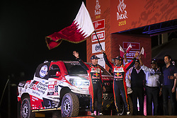 LIMA, Jan. 7, 2019  Qatar driver Nasser Al Attiyah (2nd L) and French co-driver Matthieu Baumel pose on the podium during the departure ceremony at the 2019 Dakar Rally Race, Lima, Peru, on Jan. 6, 2019. The 41st edition of Dakar Rally Race kicked off in Lima, Peru. (Credit Image: © Xinhua via ZUMA Wire)
