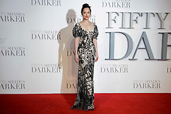Dakota Johnson (wearing Alexander McQueen) attending the UK premiere of 50 Shades Darker, at the Odeon cinema in Leicester Square, London. Picture date: Thursday February 9th, 2017. Photo credit should read: Matt Crossick/ EMPICS Entertainment.