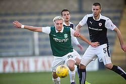 Hibernian's Jason Cummings and Raith Rovers Lewis Toshney. <br /> Raith Rovers 1 v 2 Hibernian, Scottish Championship game played 24/10/2015 at Starks Park.