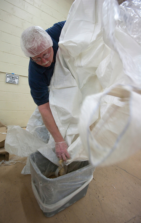 Jeff Johnson empties the last bits of soy from one of the large bags, Friday, April 9.