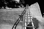 A wooden ladder leading up to the roof of the San Lorenzo Church in Picuris Pueblo, New Mexico.