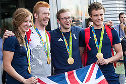 © Licensed to London News Pictures . 18/08/2016 . Manchester , UK . L-R Olympic cyclists JOANNA ROWSELL MBE , ED CLANCY MBE , JASON KENNY OBE and STEVEN BURKE MBE arrive at Manchester Airport after medal success at the Rio Olympics . Photo credit : Joel Goodman/LNP