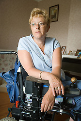 Portrait of a woman in wheelchair; looking thoughtful,