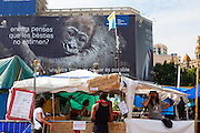 "Protest camp at Placa de Catalunya, Barcelona, Spain. Behind is a Hyundai advertisement, which reads ""Still believe that animals do not love? Another way of thinking is possible"". The square has been relatively quiet since police attacked and beat protestors on May 27 2011."