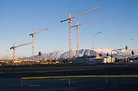 Building Cranes at The Icelandic National Concert & Conference Centre building cite in Reykjavik. Mountain Esja in background. Byggingarkranar við byggingarsvæði Tónlistarhússins í Reykjavík. Esjan í baksýn.