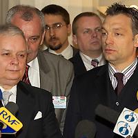 Viktor Orban and Lech Kaczynski speak on a press conference following their meeting.