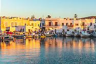 Naousa, Paros, Greece - July 2021: Naousa seaside shore at sunset
