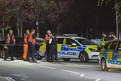 © Licensed to London News Pictures. 31/05/2021. London, UK. Police and Transport for London emergency personal at the crime scene at Montrose Park, Edgware following the fatal stabbing of an 18-year-old male. Metropolitan Police were called at 17:54 BST on Monday 31/05/2021 following reports of a group of males fighting. The man was found suffering from a stab injury in a tennis court area. He was treated by London's Air Ambulance and London Ambulance Service at the scene but was pronounced dead at 19:19 BST. Photo credit: Peter Manning/LNP