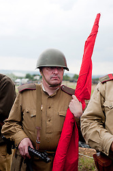 """A Re-enactor portrays a Soviet soldier from the Russian 13th Guards Rifle Division """"Poltavaskaya"""" during the """"Spam 1940s Wartime Weekend"""" at the Ponderosa in Heckmondwike<br /> 10th July 2011.<br /> Images © Paul David Drabble"""