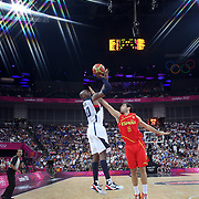 Kobe Bryant, USA,  shoots over Jose Calderon, Spain, in action during the Men's Basketball Final between USA and Spain at the North Greenwich Arena during the London 2012 Olympic games. London, UK. 12th August 2012. Photo Tim Clayton