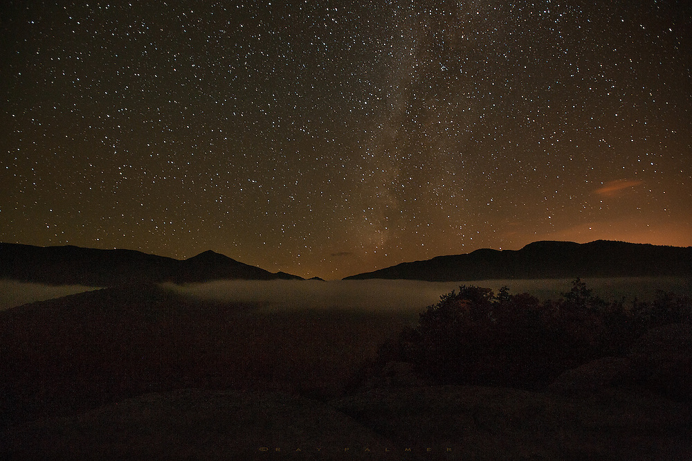 Owl's Head Mountain, Adirondacks, NY.  I awake, again.   How is it that I come here to get away and there everything is, still banging around in my head.  So I get up, and see that the Way has risen as well, and runs like a nebulous cloud above.  In the valley below, fog has risen in an inversion layer,  lit by the heavens above.  I take a few shots, and then sit to watch for shooting stars for awhile.  Maybe this is something God wants me to see, that there are endlessly more things out there than my insignificant problems.  I yield, and retire to my tent to try and sleep sleep.