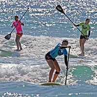 Team Roxy girls compete in an exciting relay of Stand Up Paddling, sponsored by Surftech, at the 2008 3rd Annual Roxy Jam in Cardiff.