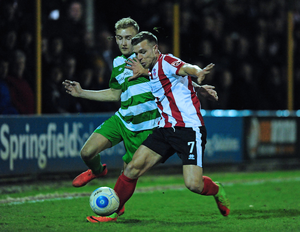 North Ferriby United's Taron Hare under pressure from Lincoln City's Jack Muldoon<br /> <br /> Photographer Chris Vaughan/CameraSport<br /> <br /> Vanarama National League - North Ferriby United v Lincoln City - Tuesday 21st February 2017 - Grange Lane - North Ferriby<br /> <br /> World Copyright © 2017 CameraSport. All rights reserved. 43 Linden Ave. Countesthorpe. Leicester. England. LE8 5PG - Tel: +44 (0) 116 277 4147 - admin@camerasport.com - www.camerasport.com