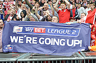 Fleetwood Town fans celebrate as they  hold up a 'We're going up!' banner. Skybet football league two play off final match , Burton Albion v Fleetwood Town at Wembley Stadium in  London on Monday 26th May 2014.<br /> pic by John Patrick Fletcher, Andrew Orchard sports photography.
