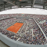 PARIS, FRANCE June 09.  A fish eye view of Rafael Nadal of Spain in action against Dominic Thiem of Austria during the Men's Singles Final on Court Philippe-Chatrier at the 2019 French Open Tennis Tournament at Roland Garros on June 9th 2019 in Paris, France. (Photo by Tim Clayton/Corbis via Getty Images)