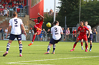 Football - 2021 / 2022 Emirates FA Cup - First Round Qualifying - Worthing vs Corinthian-Casuals - The Crucial Environment Stadium, Woodside Road - Saturday 4th September 2021<br /> <br /> Worthing's Mo Diallo has a shot on goal blocked by Coskun Ekim of Corinthian Casuals in the final minutes at The Crucial Enviromental Stadium <br /> <br /> COLORSPORT/SHAUN BOGGUST