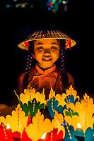 Girl holding paper lanterns, Hoi An Full moon lantern festival, Hoi An, central Vietnam.
