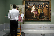 painter reproducing a part of Velazquez - The Drunkards or The Triumph of Bacchus Metropolitan Museum of Art New York