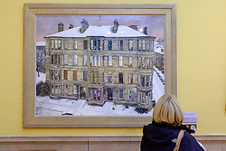 Visitor looking at painting Windows in the West by Avril Paton  on display at Kelvingrove Art Gallery and Museum in Glasgow United Kingdom