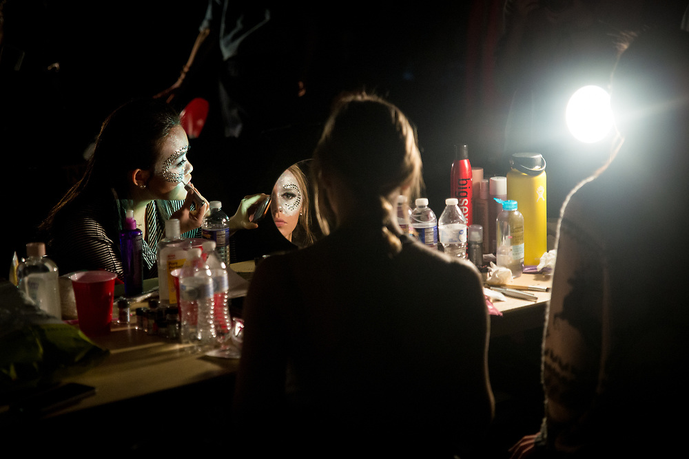 Rachael Kalousdian '18 has her makeup done before modeling in Kaya Middleton's collection at The Cornell Fashion Collective's annual runway show in Barton Hall on March 10, 2018.<br /> <br /> Credit: Cameron Pollack / The Cornell Daily Sun