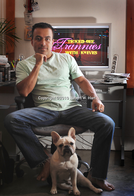 """FIlm director Israel Luna at his home editing station in Dallas. Luna is the director of """"Ticked Off Trannies With Knives."""""""