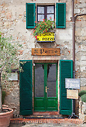 A small restaurant in the medieval, hilltop town of Monteriggioni in Tuscany, Italy