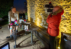 © Licensed to London News Pictures; 27/05/2021; Bristol, UK. KATE STRONG cycles through the night in her attempt on 3 world records for static cycling, aiming to set world records for the furthest distance cycled on a static bike in 24 hours by a female, the current 1-hour and 12-hour world records at the same time. Since 3pm on 26 May Kate has now set two new world records (to be confirmed) for the 1-hour and 12-hour distance records. This world record attempt is taking place on 26-27 May 2021 at The Observatory in Clifton, Bristol, starting at 3pm on Wednesday and finishing at 3pm on Thursday. Guinness has set the minimum target for 24 hours at 680km (422.53 miles) for it to be recognised as a World Record. Photo credit: Simon Chapman/LNP.
