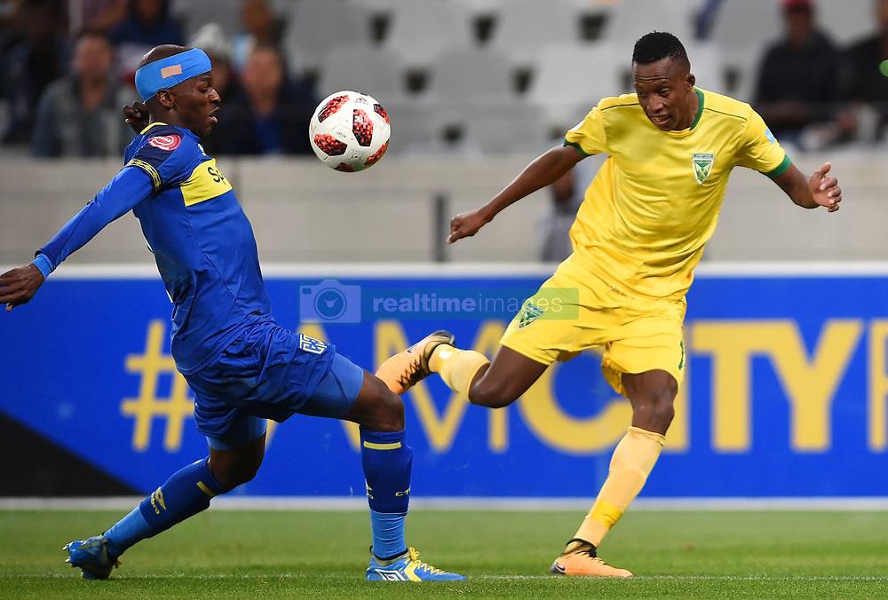 Cape Town-180818 Cape Town City defender Thami Mkhize  challenged by Devine Lunga  of Golden Arrows in a PSL match at Cape Town Stadium .photograph:Phando Jikelo/African News Agency/ANA