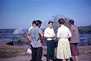 Group of tourists at Iguazu Falls waterfalls on Iguazu River at the border of Brazil and Argentina, South America in 1962
