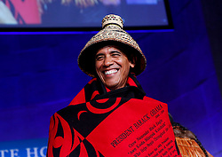 US President Barack Obama receives a traditional blanket and hat during the 2016 White House Tribal Nations Conference at the Andrew W. Mellon Auditorium, September 26, 2016, Washington, DC, USA. The conference provides tribal leaders with opportunity to interact directly with federal government officials and members of the White House Council on Native American Affairs. Photo by Aude Guerrucci/Pool/ABACAPRESS.COM  | 564551_001