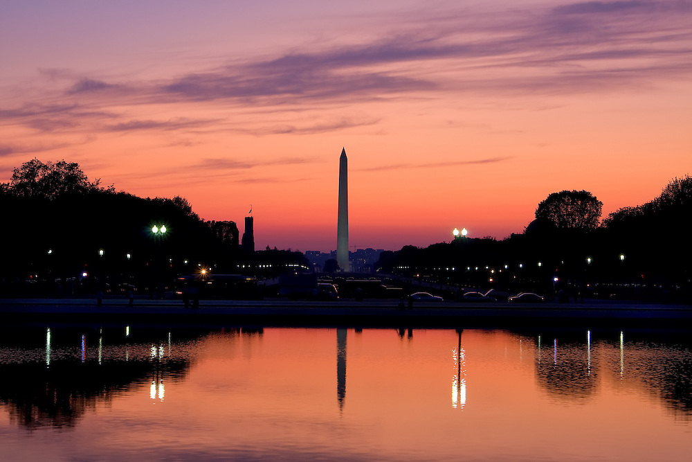 A spectacular fall sunset casts its pink hues on the Washington Monument and the National Mall, which in turn cast reflections in the nearby reflecting pool in Washington, DC