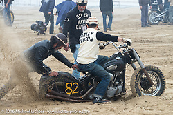 Atsushi Yasui helps Mr. Miya get his Knucklehead got stuck in the soft sand getting to the pits before the start of TROG West - The Race of Gentlemen. Pismo Beach, CA, USA. Saturday October 15, 2016. Photography ©2016 Michael Lichter.