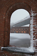 New York. Brooklyn under the snow . under Brooklyn bridge . the old tobacco factory  New York  Usa /  anciens entrepots de tabac renoves sous le pont de Brooklyn .  New York