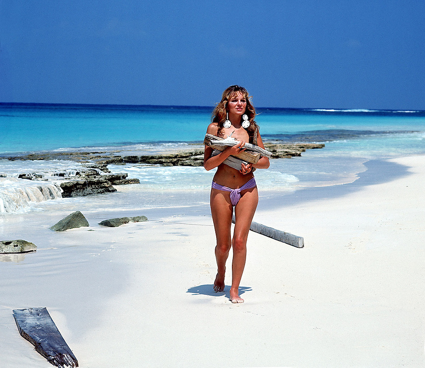 Model and actress Julie Ege seen on a deserted island in Abaco, Bahamas in 1971. Photographed by Terry Fincher
