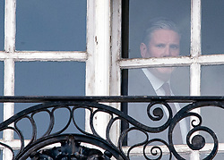 © Licensed to London News Pictures. 07/05/2021. London, UK. Labour Party Leader Sir KEIR STARMER is seen at the window of his office in Westminster, as counting continues in Local and Mayoral elections. Photo credit: Ben Cawthra/LNP