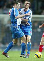 Fotball<br /> Premier League England 2004/2005<br /> 21.11.2004<br /> Foto: SBI/Digitalsport<br /> NORWAY ONLY<br /> <br /> Blackburn v Birmingham<br /> Barclays Premiership. 21/11/2004. <br /> <br /> Barry Ferguson and Brett Emerton of Blackburn Rovers crash into each other.