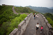 Visitors at the Mutianyu Great Wall. Mutianyu is a section of the Great Wall of China located in Huairou County 70km northeast of Beijing. The Mutianyu section of the Great Wall is connected with Jiankou in the west and Lianhuachi in the east. As one of the best-preserved parts of the Great Wall, the Mutianyu section of the Great Wall used to serve as the northern barrier defending the capital and the imperial tombs.