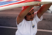 Tomasa Montanez who is originally from San Luis Potosi in Mexico holds the corner of a huge American flag before walking to Dallas City Hall during the MegaMarch for Immigration Reform,  May 01, 2010
