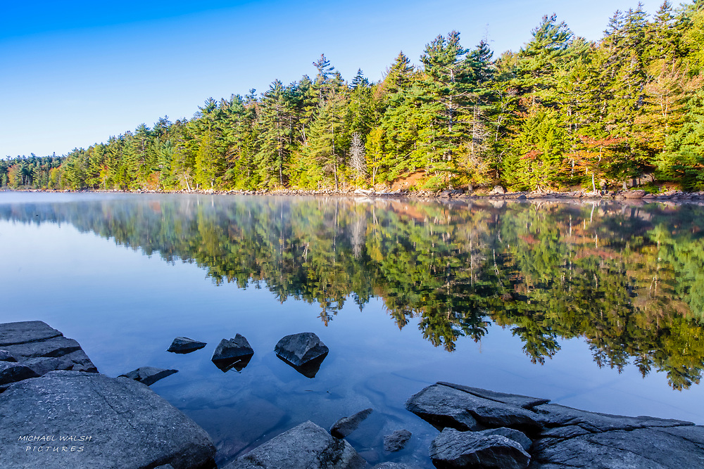 An early fall morning full of reflections and solitude on Eagle Lake.<br /> <br /> Inside Acadia National Park on Mt. Desert Island, Maine.