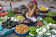 A man selling vegetables on the street in Jaipur, India