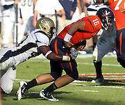 Oct. 15, 2011-Charlottesville, VA.-USA- Georgia Tech linebacker Julian Burnett (40) sacks Virginia Cavaliers quarterback Michael Rocco (16) during the ACC football game against Georgia Tech at Scott Stadium. Virginia won 24-21. (Credit Image: © Andrew Shurtleff