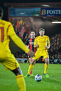 Steven Gerrard picks out Raheem Sterling during the Capital One Cup match between Bournemouth and Liverpool at the Goldsands Stadium, Bournemouth, England on 17 December 2014.